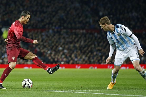 Cristiano Ronaldo in action against Cristian Ansaldi, of Argentina. Photo: AP/Jon Super