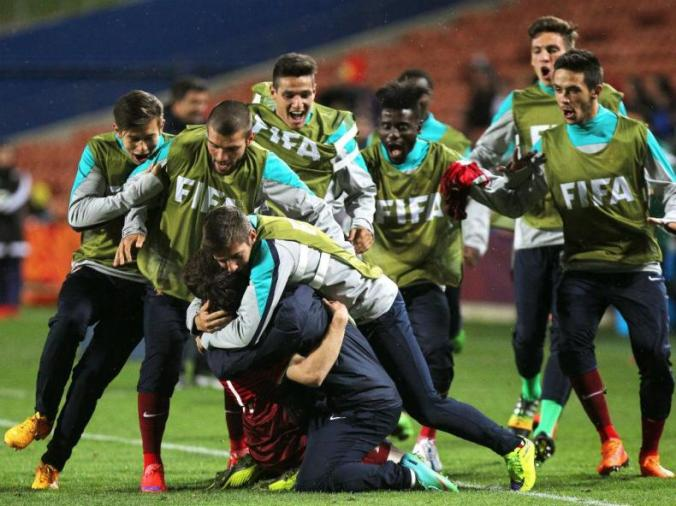 The Portuguese team celebrates with Nuno Santos, following the team's third goal.